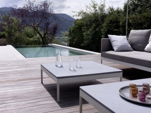 house-with-infinity-pool-and-wood-deck-with-white-and-gray-table-set1